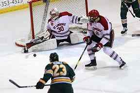 c64dba95f St. Lawrence University goalie Daniel Mannella (30) stretches to make the  pad save, blocking the shot from Clarkson right winger Marly Quince to keep  the ...