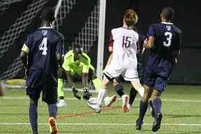 0ac34b3fa SUNY Potsdam forward Teddy Bruschini (15) fires a shot onto the SUNY Canton  goal however