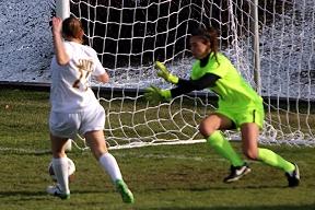 d32d9b5e7 St. Lawrence University s Megan Gannon (21) chips in the ball into the net